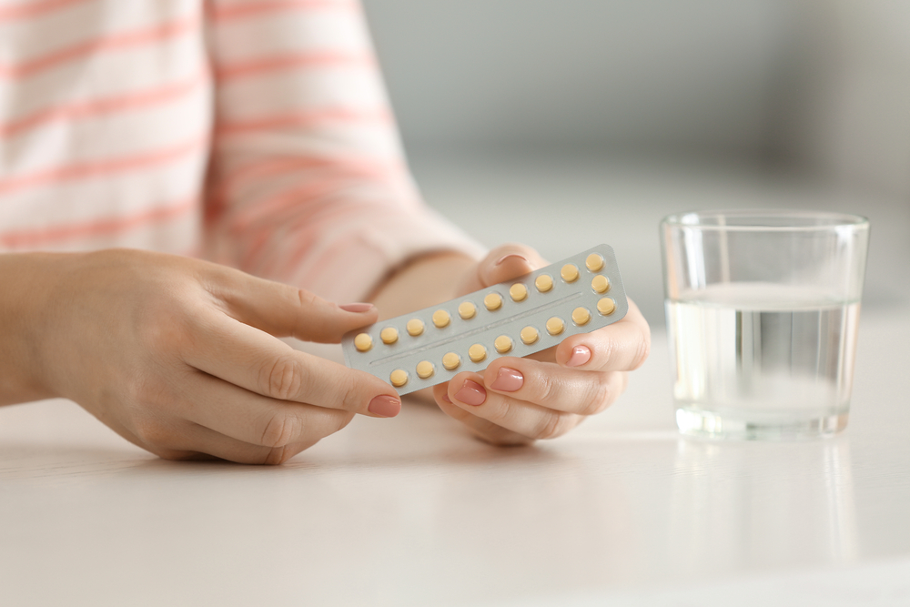 A woman learning how to use birth control pills