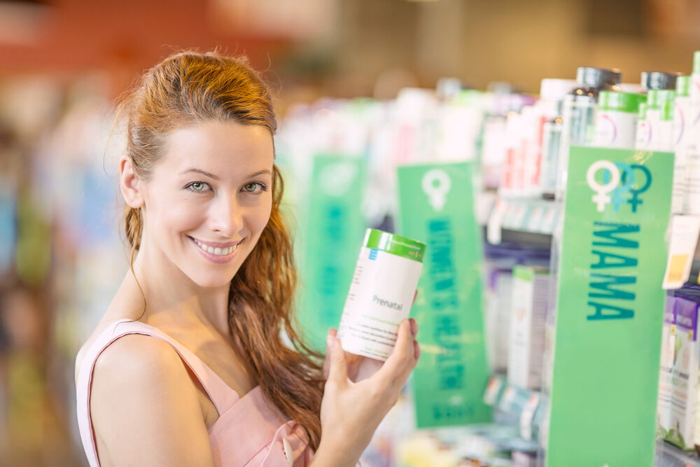 young woman picking diet supplements