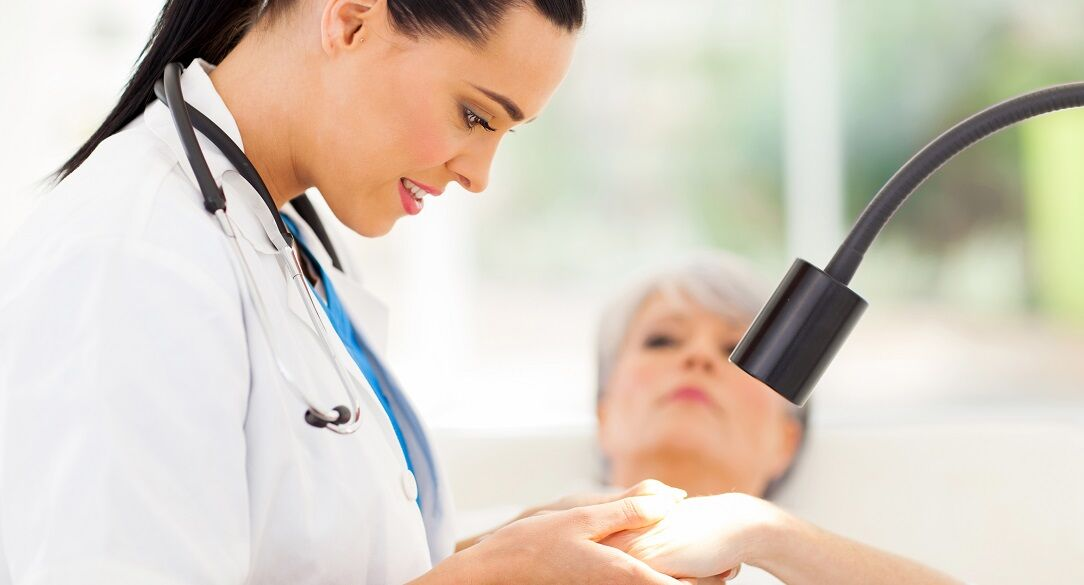 dermatologist examining a woman with skin problems