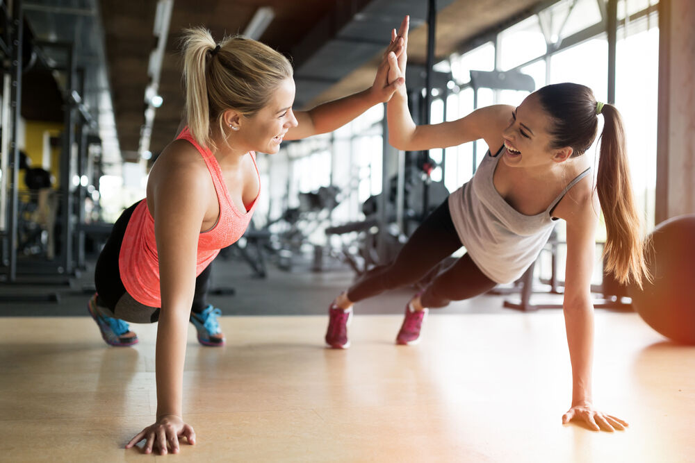 Two women exercise using the FITT principle