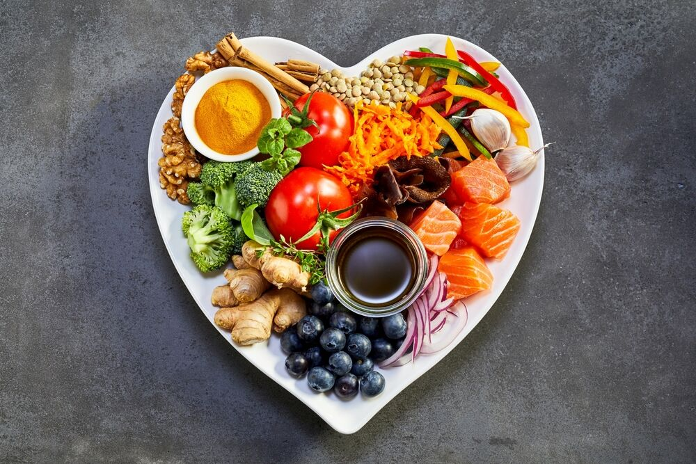 heart-shaped plate of acai, lentils, soy sauce, ginger, salmon, carrot, tomato, turmeric, cinnamon, walnuts