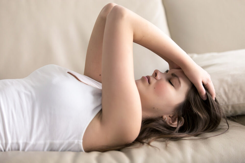 girl suffering from fatigue ten days past ovulation