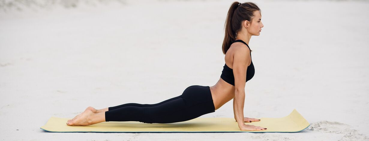 A woman practicing yoga for lower back pain and sciatica