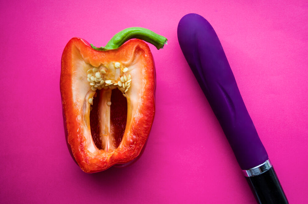 Menstruation masturbation depicted metaforically by a sex toy and a pepper