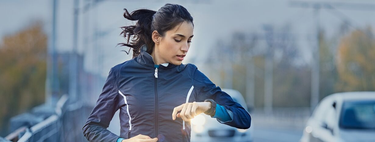 A woman preparing for a 10k race