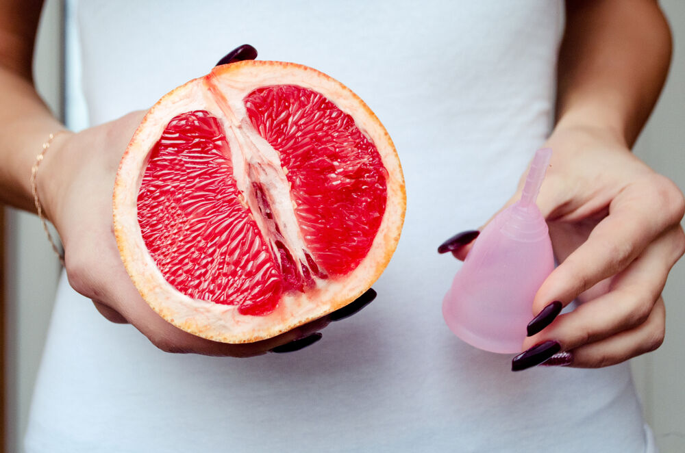 Masturbating with a menstrual cup inside depicted with the image of grapefruit