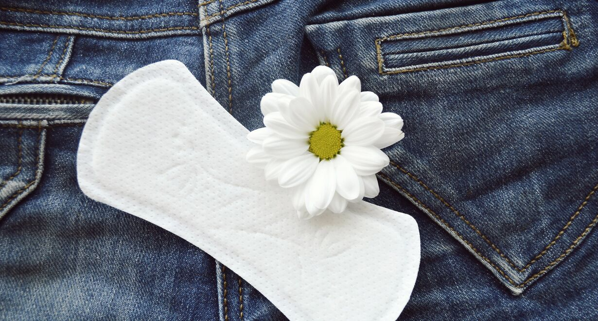 A paty liner and a flower on jeans