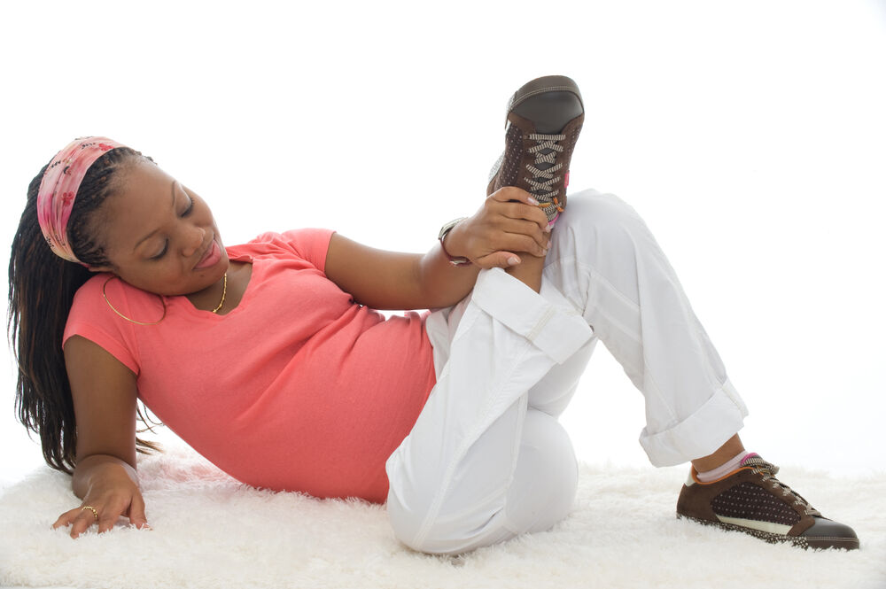 Pregnant woman wearing sneakers