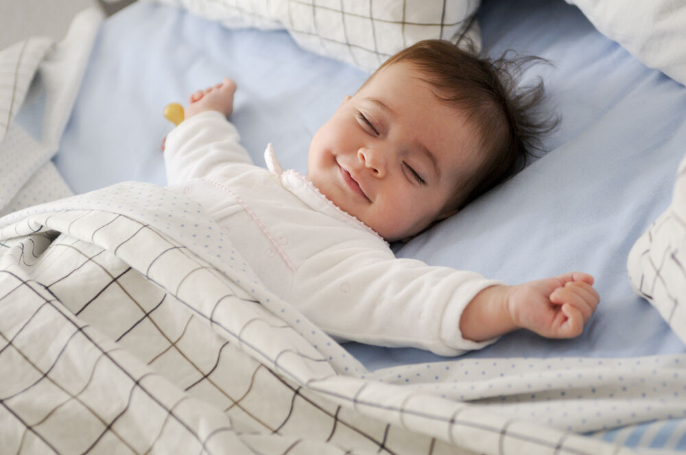 smiling baby is sleeping