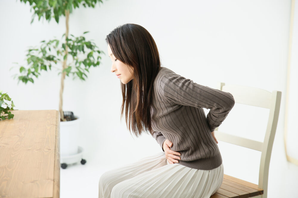 Lower back pain in the first weeks of pregnancy