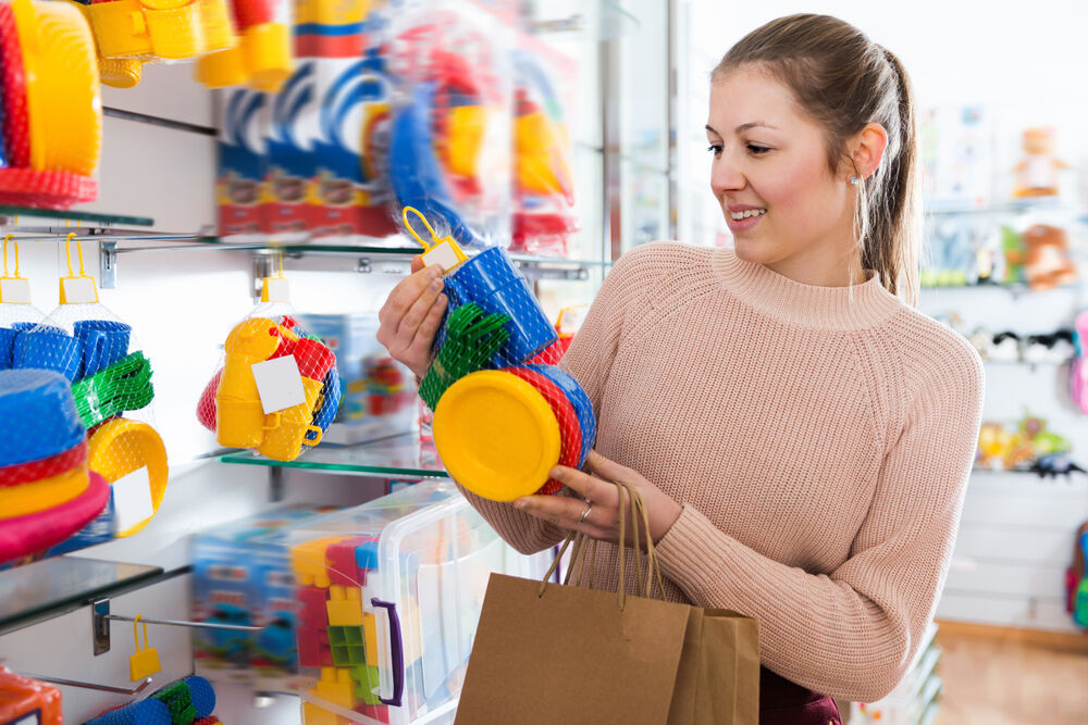A woman choosing the best toys for her 10-month-old baby