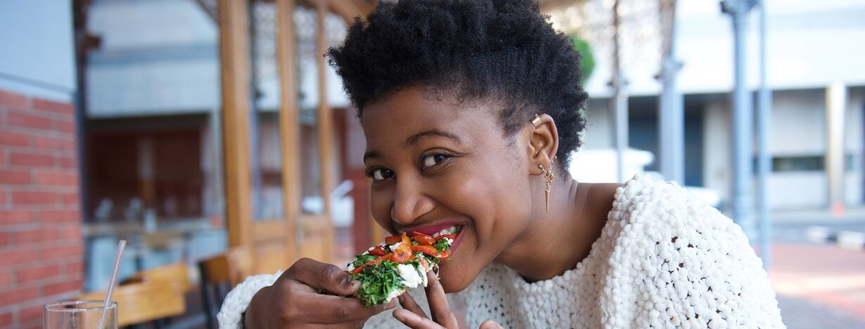 A woman eating vegan-friendly fast food