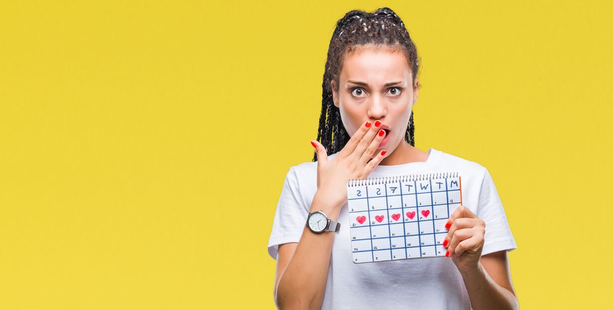 girl with calendar yellow background