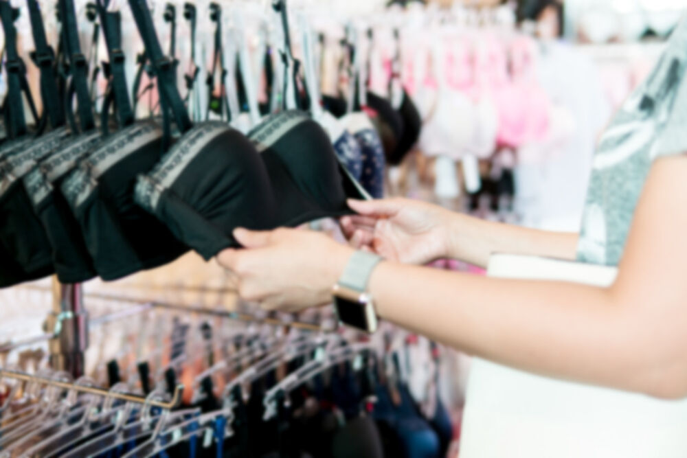 A girl choosing a bra for teen breasts