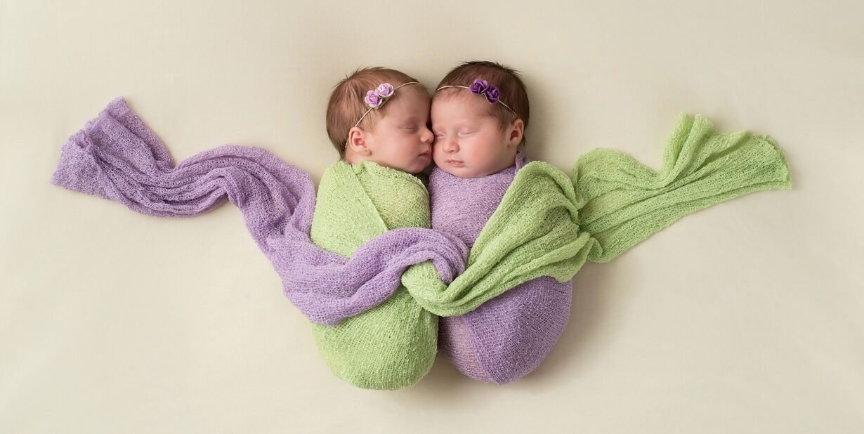 twin newborn baby girls with different fathers