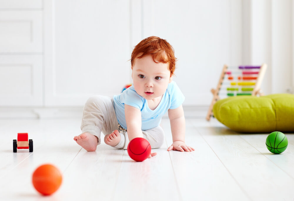 A baby playing 7-month-old baby games