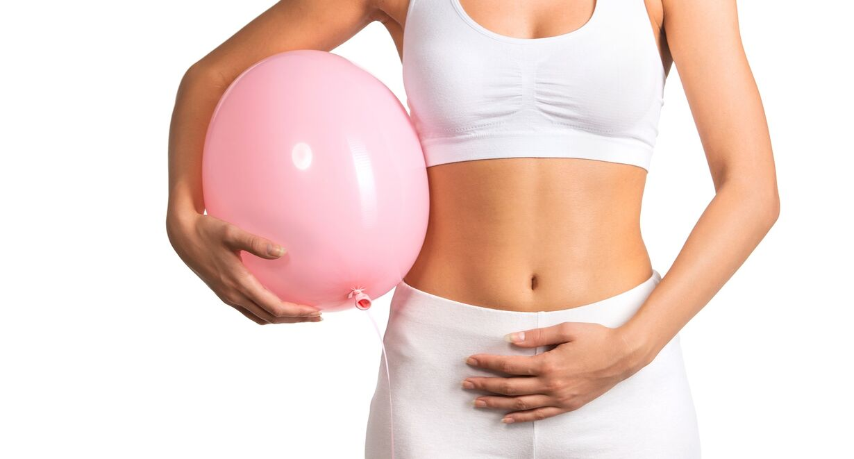 Bloating during ovulation represented by a woman with an inflated baloon